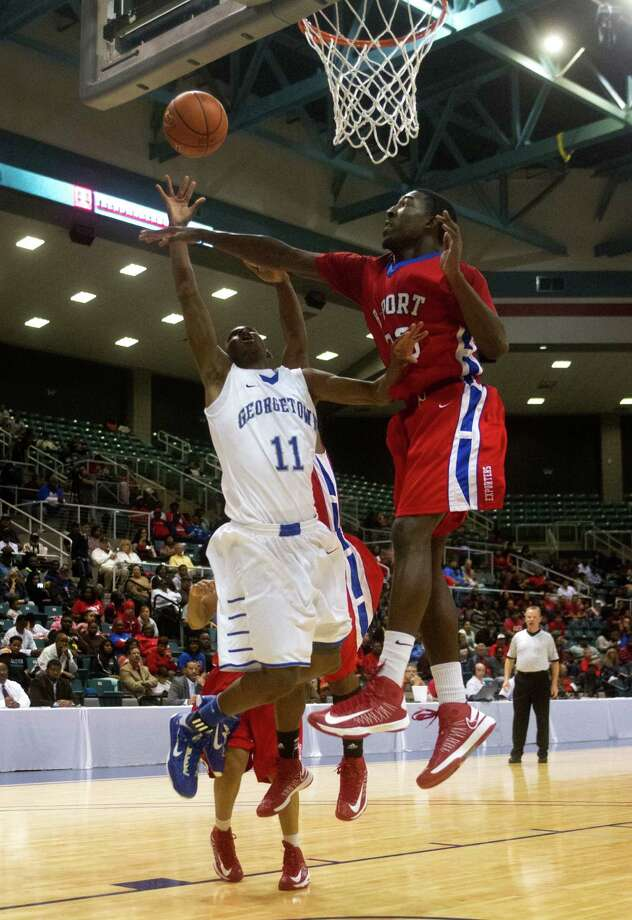 Brazosport guard Cameron Fisher (23) defends against Georgetown guard D'Andre Day (11) during the third quarter of the 4A Region III tournament at the Merrell Center on Friday, March 1, 2013, in Katy. Photo: J. Patric Schneider, For The Chronicle / © 2013 Houston Chronicle