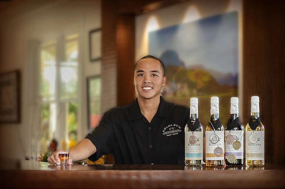"""""""Rum slinger"""" Cale Akuna at the Koloa Rum Co., which makes four varieties of rum. Photo: Koloa Rum Co."""