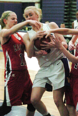 Westhill's Steph Roones fends off Smith's defense as Westhill High School hosts E.O. Smith in a girls basketball game in Stamford, Conn., March 1, 2013. Photo: Keelin Daly / Keelin Daly