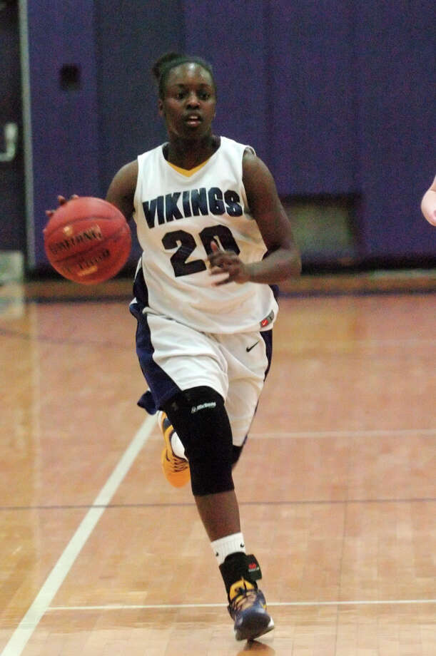 Westhill's Tyler Evans in control as Westhill High School hosts E.O. Smith in a girls basketball game in Stamford, Conn., March 1, 2013. Photo: Keelin Daly / Keelin Daly