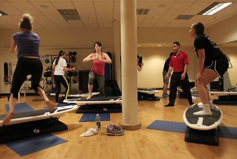 Masood Farhar, second from right, leads a SurfSet class at the Bay Club San Francisco on Saturday, Feb. 23. Working out atop a simulated surfboard helps to build muscle. Photo: James Tensuan, The Chronicle