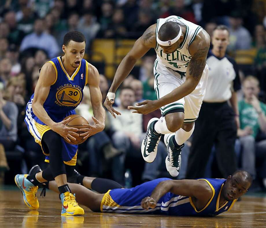 Boston Celtics' Chris Wilcox (44) jumps over Golden State Warriors' Carl Landry, bottom right, as he battles the Warrior's Stephen Curry (30) for the ball during the first quarter of an NBA basketball game in Boston, Friday, March 1, 2013. (AP Photo/Michael Dwyer) Photo: Michael Dwyer, Associated Press