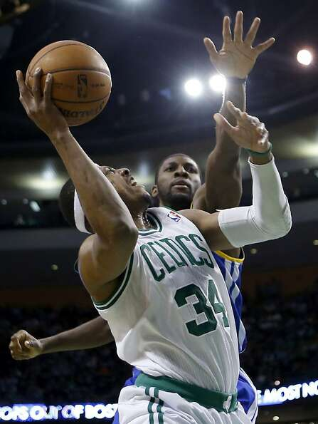 Boston Celtics' Paul Pierce (34) goes up to shoot against Golden State Warriors' Festus Ezeli during