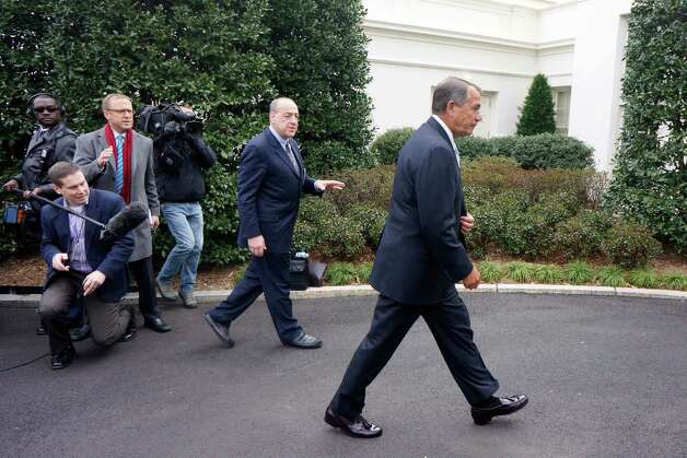House Speaker John Boehner of Ohio walks away from reporters outside the White House in Washington, Friday, March 1, 2103, without taking questions, after a meeting with President Barack Obama and Congressional leaders regarding the automatic spending cuts. (AP Photo/Charles Dharapak) Photo: Charles Dharapak
