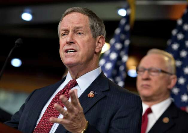 House Military Personnel subcommittee Chairman Rep. Joe Wilson, R-S.C., left, accompanied by House Armed Services Chairman Rep. Buck McKeon, R-Calif., gestures during a news conference on Capitol Hill in Washington, Friday, March 1, 2013, to talk about the effect of the automatic budget cuts on the military. (AP Photo/J. Scott Applewhite) Photo: J. Scott Applewhite