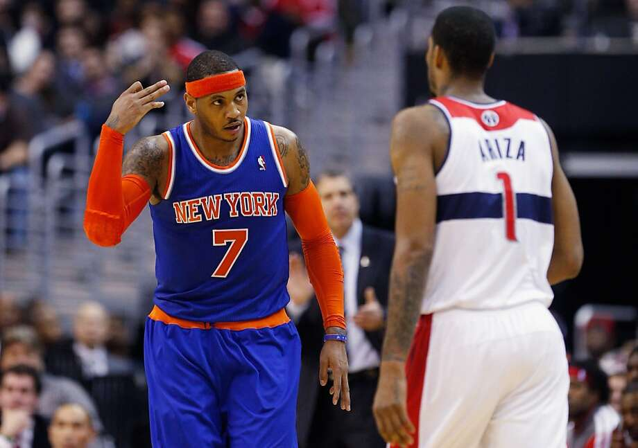 Knicks' Carmelo Anthony delivers a message to Wizards' Trevor Ariza. Photo: Rob Carr, Getty Images