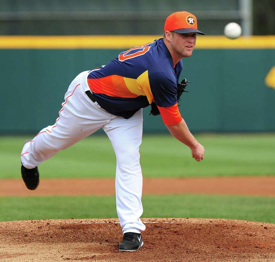 Astros starter Bud Norris, delivering in a spring training game against the Cardinals, worked three innings of an 8-8 tie Friday. He struck out one batter and walked one. Photo: Scott Cunningham / Getty Images