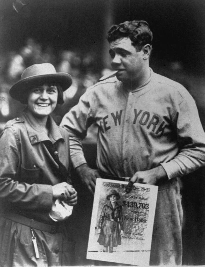 Here, of course, is Babe Ruth, enjoying his personal delivery of Girl Scout cookies ... and possibly the Girl Scout. Photo: Associated Press / AP1923