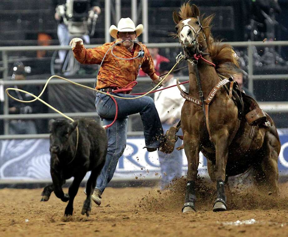 Ace Sloan on his way to a score of 11.2 seconds in the tie-down roping competition at RodeoHouston in Reliant Stadium Friday, March 1, 2013, in Houston. Photo: James Nielsen, Houston Chronicle / © 2013  Houston Chronicle