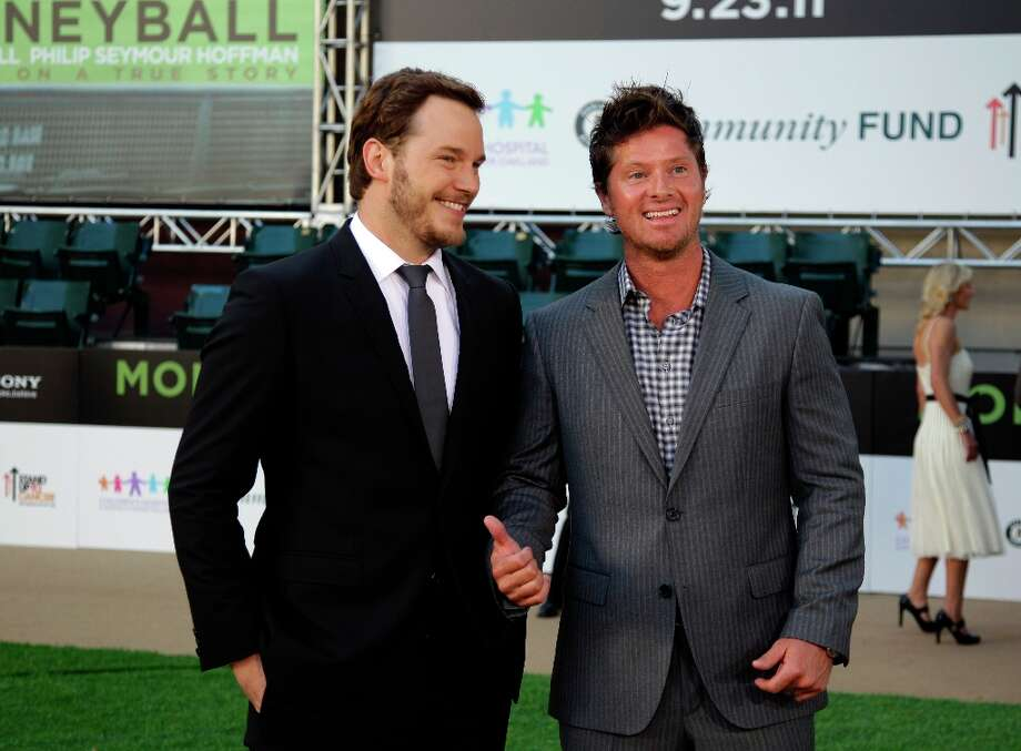 Actor Chris Pratt, left, and former Oakland Athletic Scott Hatteberg arrive at the Paramount Theatre of the Arts for the premiere screening of the movie ''Moneyball'' in Oakland, Calif. Pratt portrayed Hatteberg in the film. Photo: Ben Margot, AP / AP