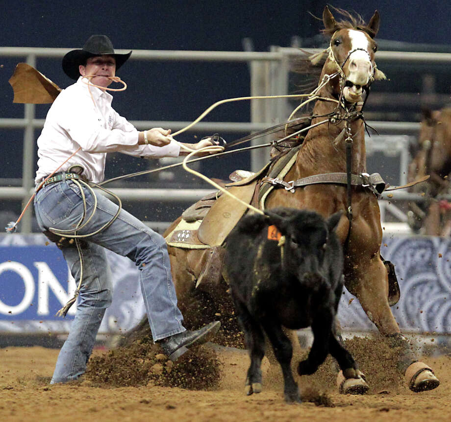 EJ Roberts on his way to a score of 9.2 seconds in the tie-down roping competition at RodeoHouston in Reliant Stadium Friday, March 1, 2013, in Houston. Photo: James Nielsen, Houston Chronicle / © 2013  Houston Chronicle
