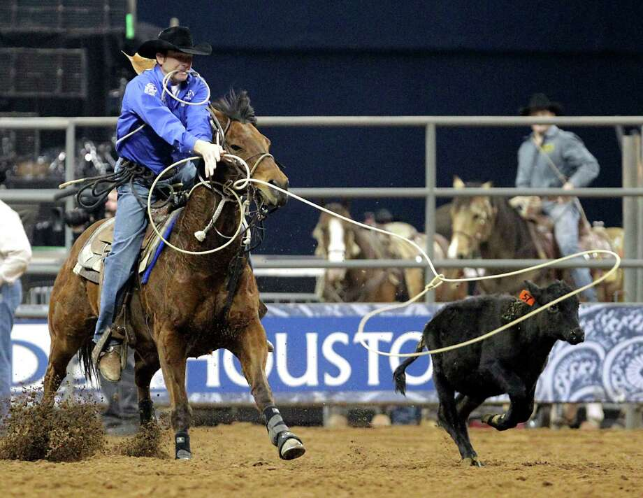 Houston Hutto on his way to a score of 10.6 seconds in the tie-down roping competition at RodeoHouston in Reliant Stadium Friday, March 1, 2013, in Houston. Photo: James Nielsen, Houston Chronicle / © 2013  Houston Chronicle