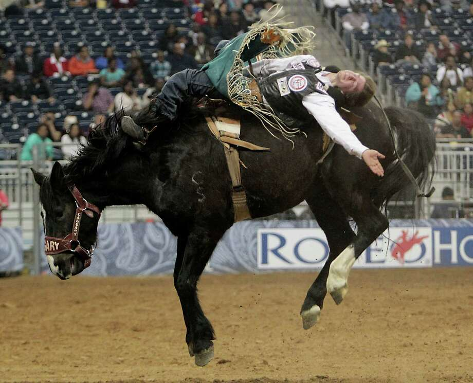 Justin McDaniel competes in the Bareback Riding event at RodeoHouston in Reliant Stadium Friday, March 1, 2013, in Houston. Photo: James Nielsen, Houston Chronicle / © 2013  Houston Chronicle
