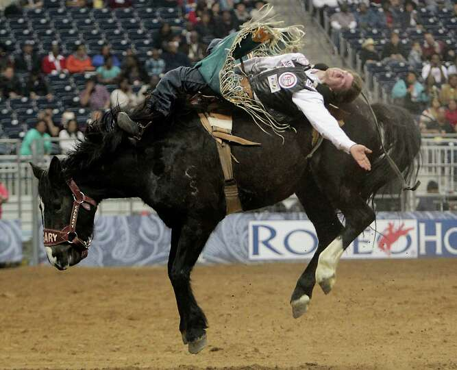 Justin McDaniel competes in the Bareback Riding event at RodeoHouston in Reliant Stadium Friday, Mar