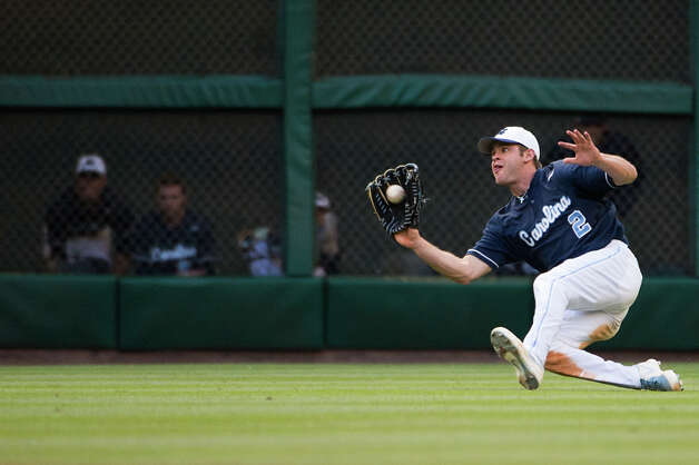 North Carolina outfielder Chaz Frank makes a sliding catch on a line drive by Rice's Ford Stainback during the fifth inning. Photo: Smiley N. Pool, Houston Chronicle / © 2013  Houston Chronicle