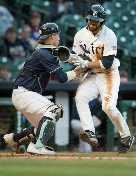 Rice's Michael Aquino is tagged out at home by North Carolina catcher Matt Roberts as he tries to sc