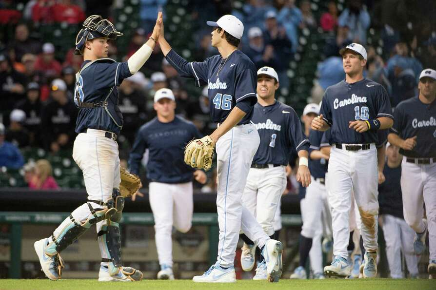 North Carolina Luis Paula (46) celebrates with catcher Korey Dunbar after a victory over Rice.