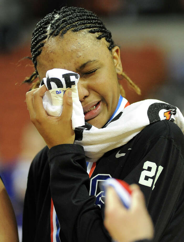 CLear Springs' Ryshinique Ball sheds a tear after losing to Duncanville during the UIL girls basketball 5A semi-final on Fri., March 1, 2013 at the Frank Erwin Center. Photo: Ashley Landis / copyright 2013 Ashley Landis