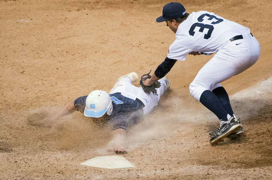 North Carolina outfielder Chaz Frank touches the plate just ahead of the tag from Rice pitcher Zech Lemond  to score the winning run on a wild pitch in the ninth inning. Photo: Smiley N. Pool, Houston Chronicle / © 2013  Houston Chronicle