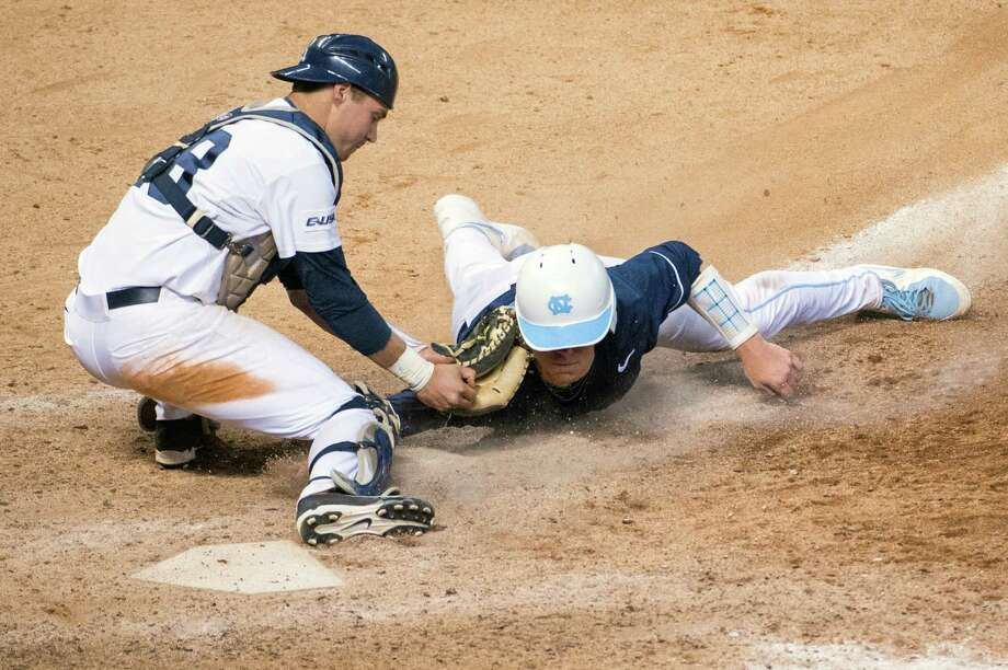 Rice catcher Geoff Perrott applies the tag as North Carolina's Korey Dunbar is out at home in the ninth inning during the Astros Foundation College Classic at Minute Maid Park, Friday, March 1, 2013, in Houston. Photo: Smiley N. Pool, Houston Chronicle / © 2013  Houston Chronicle