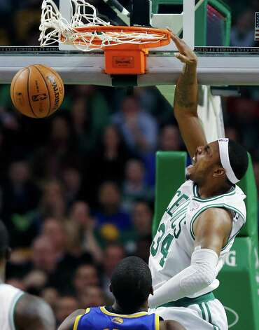 Boston Celtics' Paul Pierce (34) dunks during the third quarter of an NBA basketball game against the Golden State Warriors in Boston, Friday, March 1, 2013. The Celtics won 94-86. (AP Photo/Michael Dwyer) Photo: Michael Dwyer