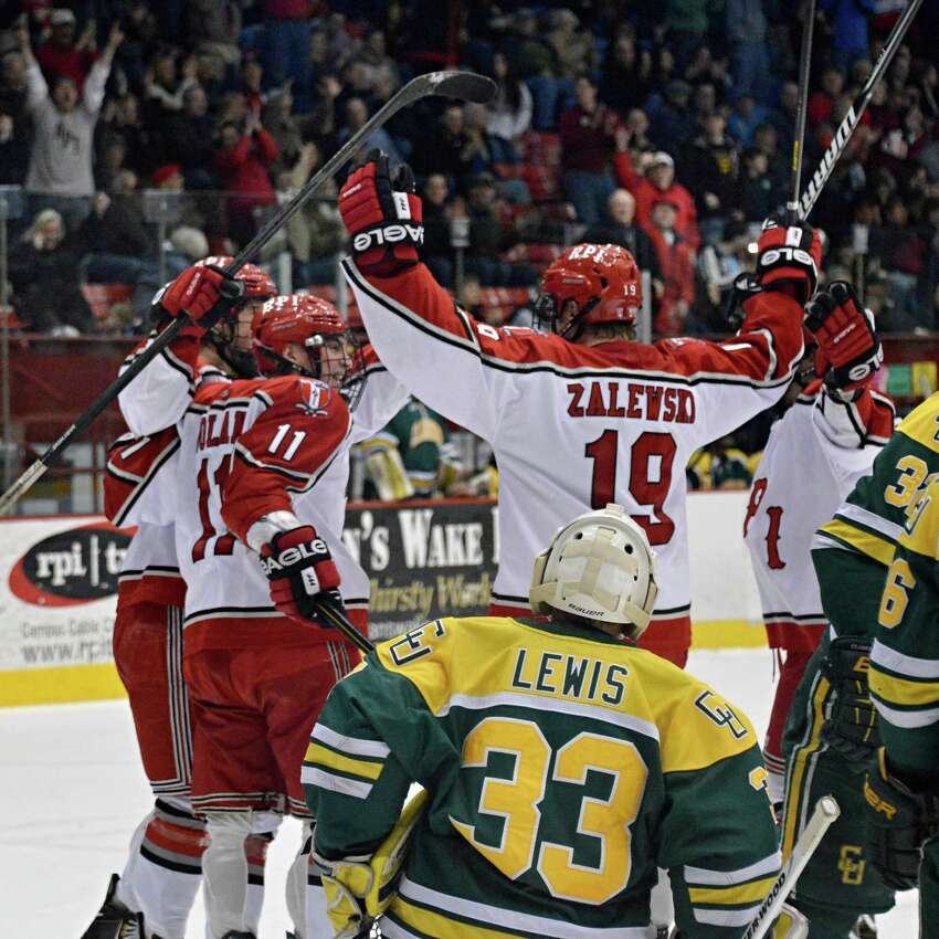 RPI players celebrate a goal ny Milos Bubela in front of Clarkson's goalie Greg Lewis during Friday's game at the Houston Field House in Troy Friday March 1, 2013. (John Carl D'Annibale / Times Union)