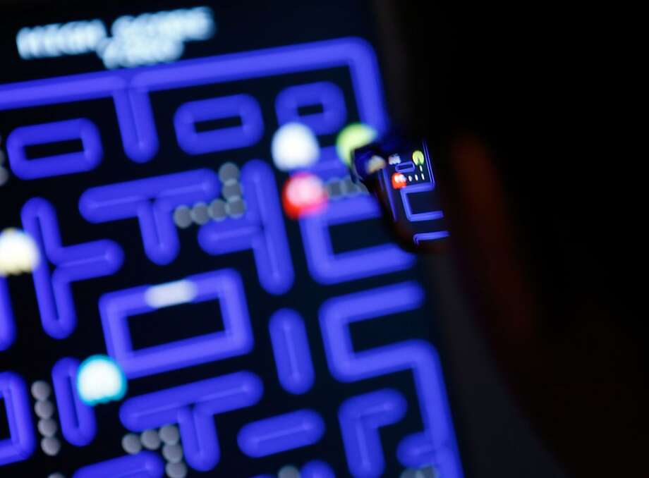"Janelle Grace plays ""Pac-Man"" which is one of the 14 video games that are part of the exhibiton ""Applied Designs"" during the ""Applied Design"" press preview at The Museum of Modern Art on March 1, 2013 in New York City. Photo: Jemal Countess, Getty Images"
