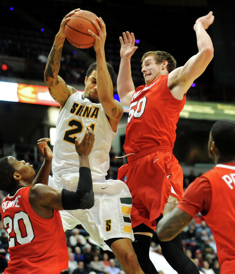Siena's Davis Martens (21), left, grabs the rebound over Marist's Adam Kemp (50) during their basketball game on Friday, March 1, 2013, at Times Union Center in Albany, N.Y. (Cindy Schultz / Times Union) Photo: Cindy Schultz / 10021367A