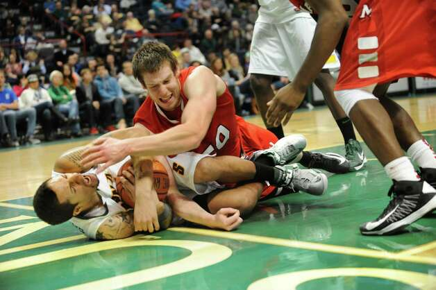 Siena's Davis Martens (21), bottom, battles Marist's Adam Kemp (50) for a loose ball during their basketball game on Friday, March 1, 2013, at Times Union Center in Albany, N.Y. (Cindy Schultz / Times Union) Photo: Cindy Schultz / 10021367A