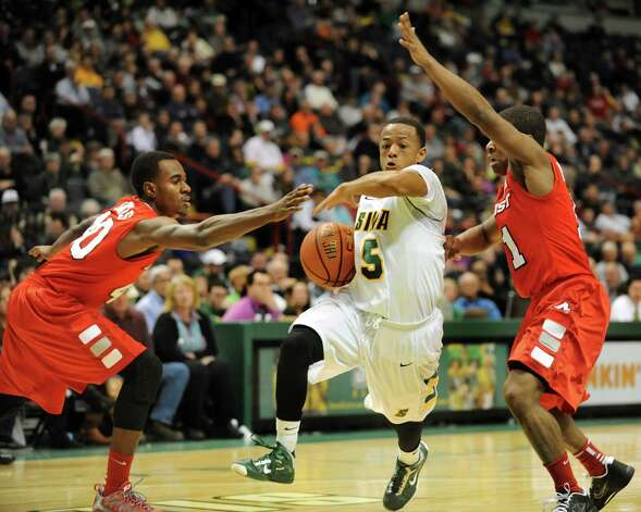 Siena's Evan Hymes (5), center, slices through the defense of Marist's Chavaughn Lewis (40), left, and Isaiah Morton (11) during their basketball game on Friday, March 1, 2013, at Times Union Center in Albany, N.Y. (Cindy Schultz / Times Union) Photo: Cindy Schultz / 10021367A