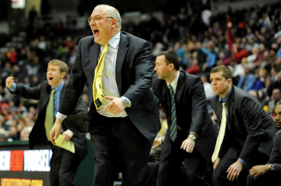 Siena's coach Mitch Buonaguro, center, and his assistants react to a foul call in the final seconds of their basketball game against Marist on Friday, March 1, 2013, at Times Union Center in Albany, N.Y. (Cindy Schultz / Times Union) Photo: Cindy Schultz / 10021367A