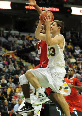 Siena's Rob Poole (33), right, goes to the hoop as Marist's Jay Bowie (20) defends, during their basketball game on Friday, March 1, 2013, at Times Union Center in Albany, N.Y. (Cindy Schultz / Times Union) Photo: Cindy Schultz / 10021367A