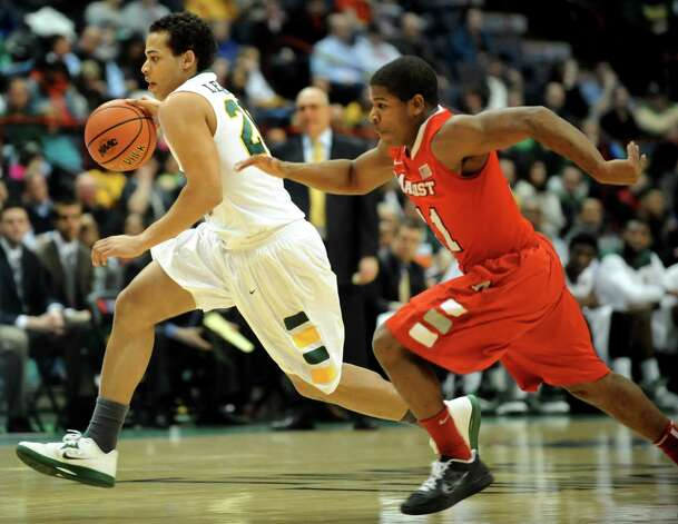 Siena's Chris Leppanen (20), left, drives up court as Marist's Isaiah Morton (11) defends during their basketball game on Friday, March 1, 2013, at Times Union Center in Albany, N.Y. (Cindy Schultz / Times Union) Photo: Cindy Schultz / 10021367A