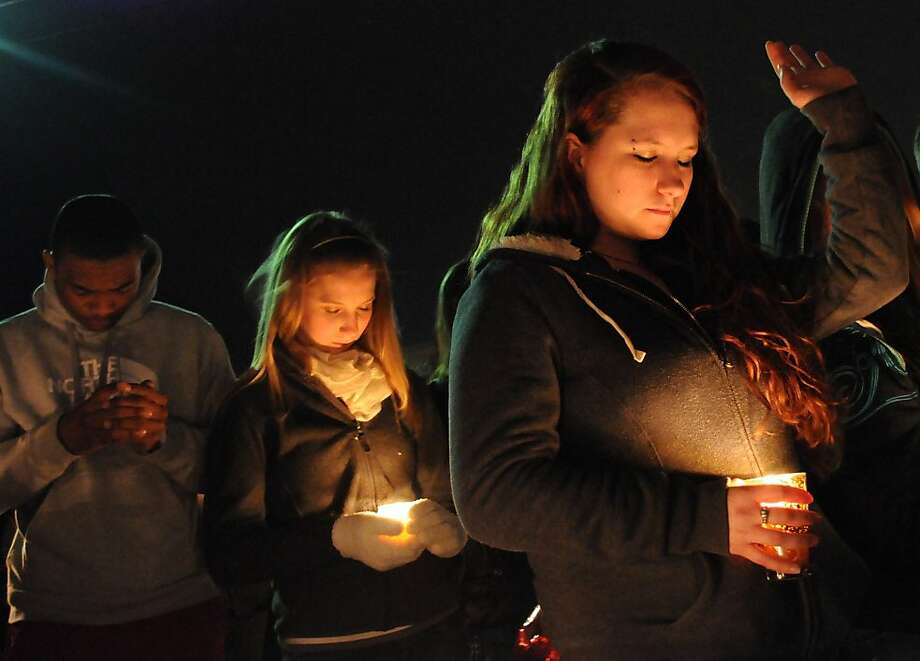 "Kelsey Wyer, at right, was among hundreds at a vigil for Russell ""Rusty"" Mack held Friday, March 1, 2013 outside of his apartment in Colonial Heights, Va. Mack died of his injuries weeks after a mob assault in which four people, including his estranged wife and a 17-year-old girl, are now facing murder charges. Photo: Patrick Kane, Associated Press"