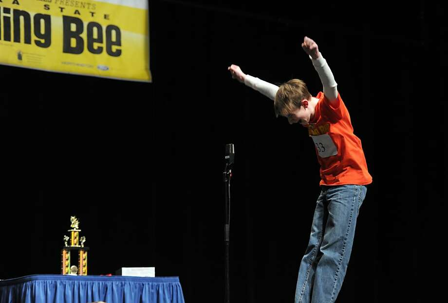 """Bryce Tasso exults as he correctly spells """"neuropathy"""" to claim first place in the 2013 Alaska State Spelling Bee at the Alaska Center for the Performing Arts in Anchorage, Alaska, Friday, March 1, 2013. He will represent Alaska at the Scripps National Spelling Bee in Washington, D.C. in May. Photo: Erik Hill, McClatchy-Tribune News Service"""