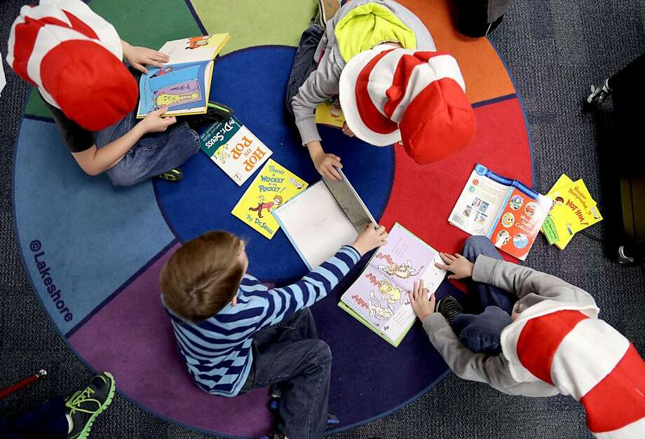Students at Aikin Elementary in Paris, Texas wear bright red and white stripped hats as they gather to read Dr. Seuss books Friday, March 1, 2013 as part of the National Education Association's Read Across America program that celebrates the author, his birthday and his works. Photo: Sam Craft, Associated Press
