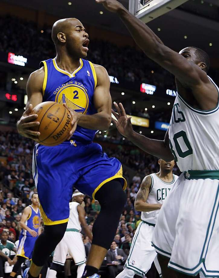 Golden State Warriors' Jarrett Jack (2) passes over Boston Celtics' Brandon Bass (30) during the third quarter of an NBA basketball game in Boston, Friday, Mar. 1, 2013. The Celtics won 94-86. (AP Photo/Michael Dwyer) Photo: Michael Dwyer, Associated Press