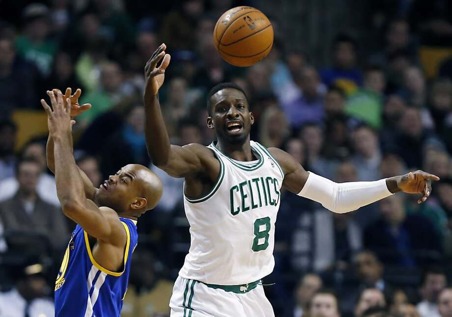 Golden State Warriors' Jarrett Jack, left, and Boston Celtics' Jeff Green (8) battle for the loose ball during the third quarter of an NBA basketball game in Boston, Friday, March 1, 2013. The Celtics won 94-86. (AP Photo/Michael Dwyer) Photo: Michael Dwyer, Associated Press