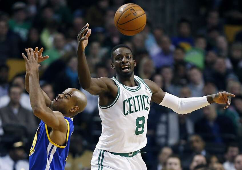 Golden State Warriors' Jarrett Jack, left, and Boston Celtics' Jeff Green (8) battle for the loose b