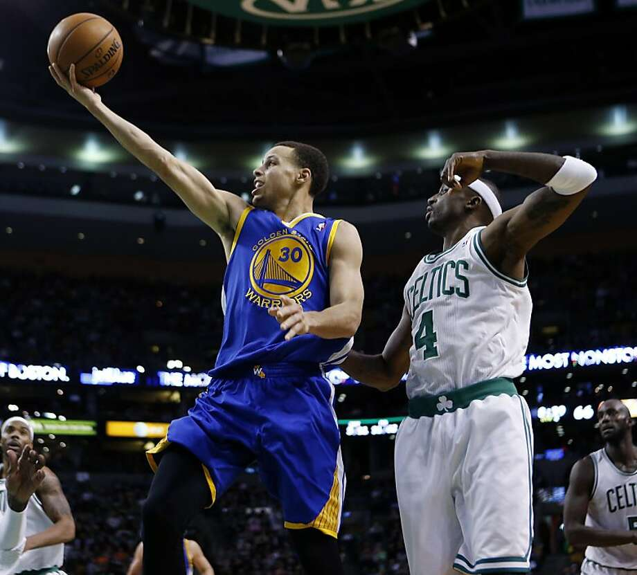 Golden State Warriors' Stephen Curry (30) shoots in front of Boston Celtics' Jason Terry (4) during the fourth quarter of an NBA basketball game in Boston, Friday, March 1, 2013. The Celtics won 94-86. (AP Photo/Michael Dwyer) Photo: Michael Dwyer, Associated Press