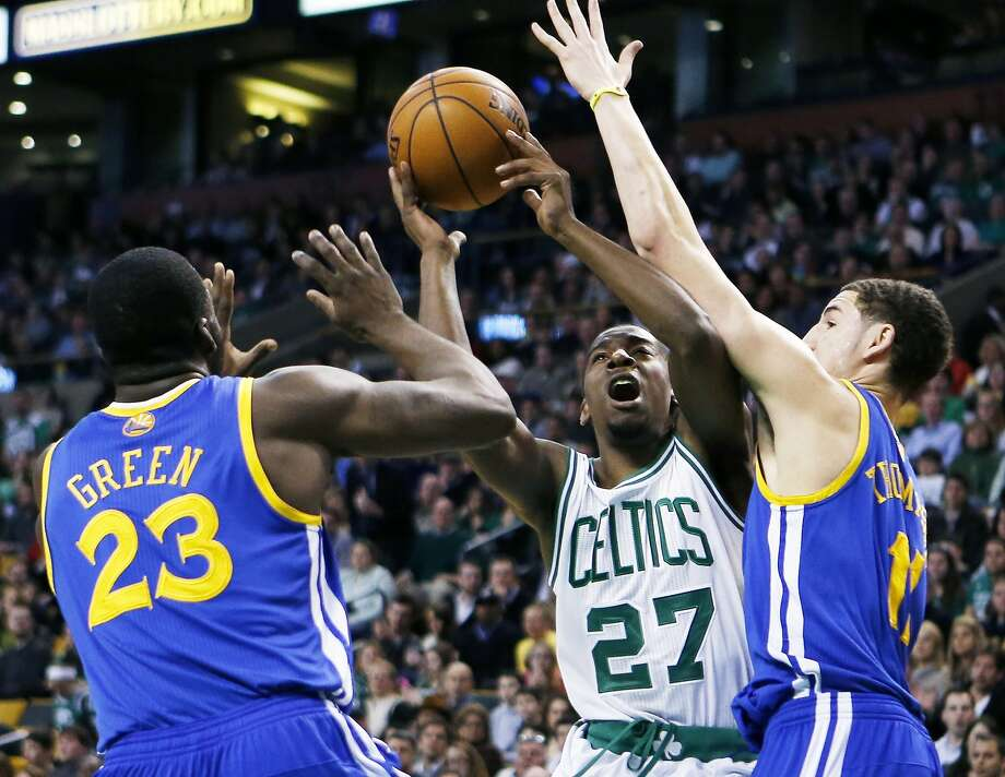 Boston Celtics' Jordan Crawford (27) tries to shoot between Golden State Warriors' Draymond Green (23) and Klay Thompson (11) during the first quarter of an NBA basketball game in Boston, Friday, March 1, 2013. The Celtics won 94-86. (AP Photo/Michael Dwyer) Photo: Michael Dwyer, Associated Press