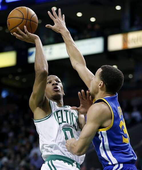 Golden State Warriors' Stephen Curry (30) blocks a shot by Boston Celtics' Avery Bradley (0) during