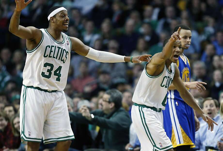 Boston Celtics' Paul Pierce (34) and teammate Avery Bradley (0) argue a call beside Golden State Warriors' Stephen Curry, right, during the second quarter of an NBA basketball game in Boston, Friday, March 1, 2013. (AP Photo/Michael Dwyer) Photo: Michael Dwyer, Associated Press