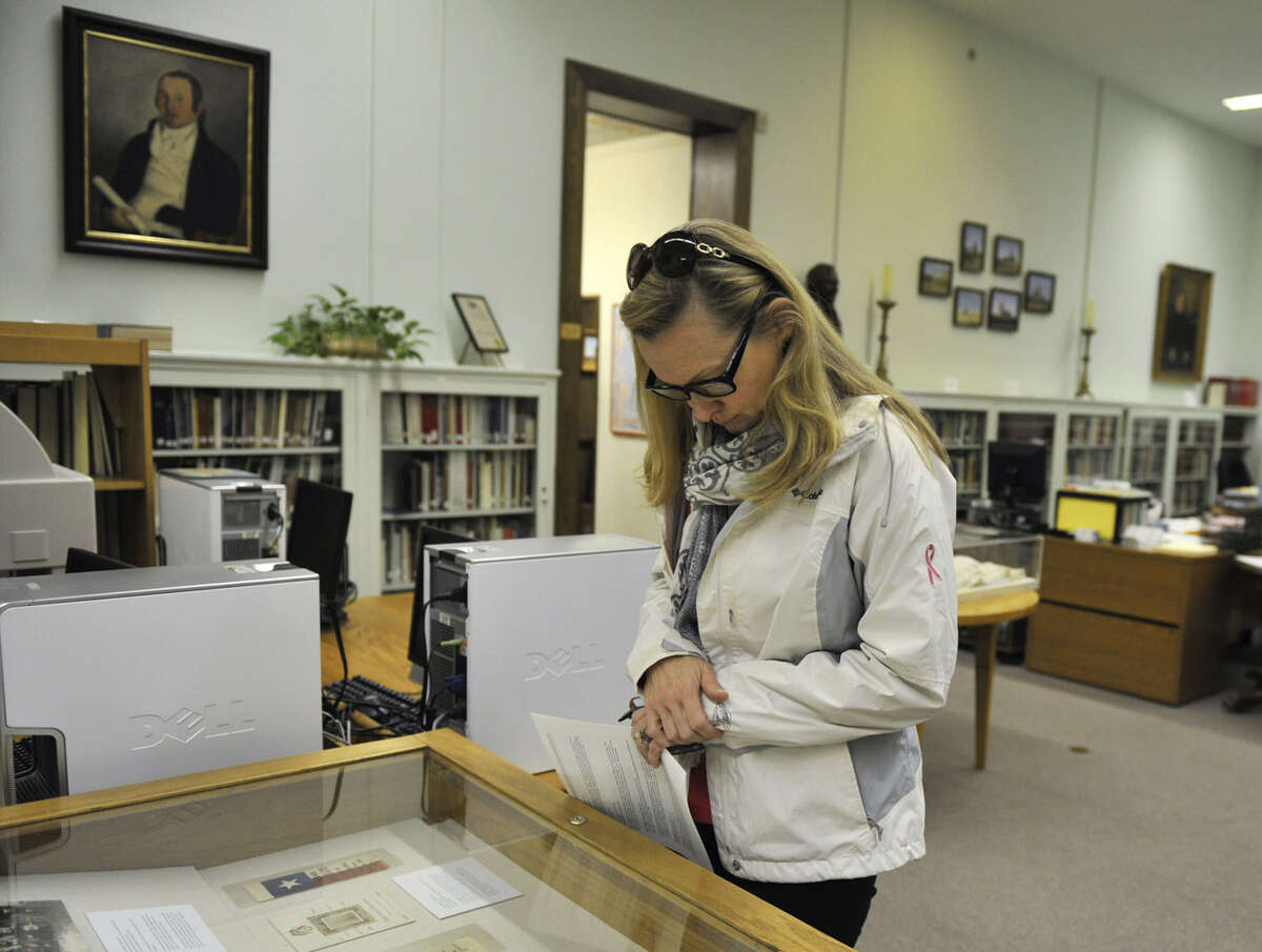 Rosie McCooe, a visitor from Ridgewood, N.J., looks over a display inside the DRT Library.