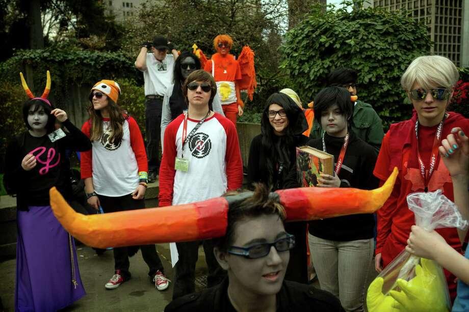 Costumed crusaders and attendees mingle together. Photo: JORDAN STEAD / SEATTLEPI.COM