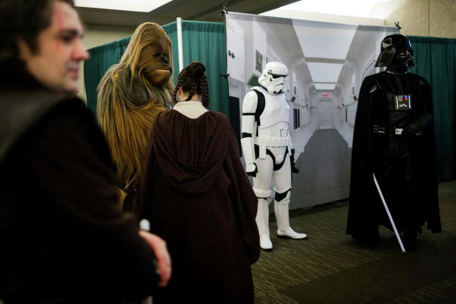 Classic Star Wars characters mingle around a donation-based photo booth. Photo: JORDAN STEAD / SEATTLEPI.COM