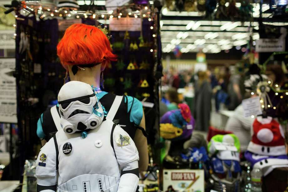 A girl sports a Star Wars stormtrooper backpack while shopping. Photo: JORDAN STEAD / SEATTLEPI.COM