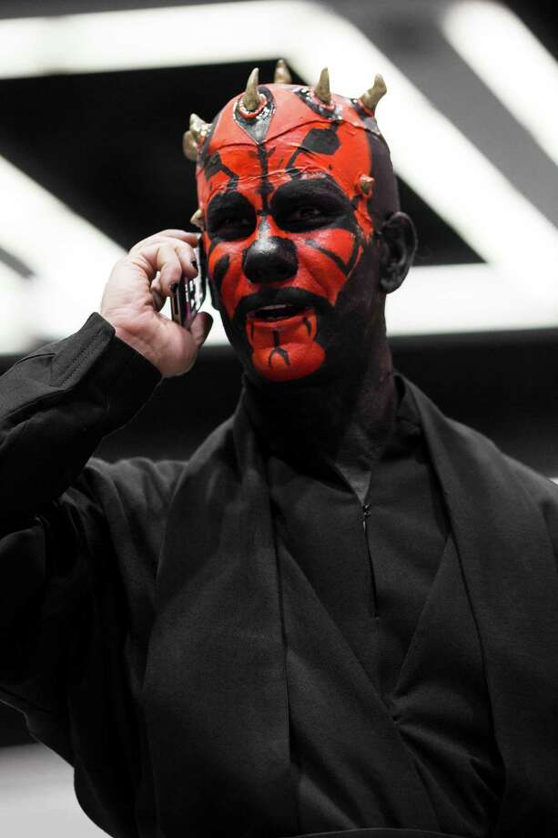 A Star Wars Sith lord makes a call on his iPhone. Photo: JORDAN STEAD / SEATTLEPI.COM