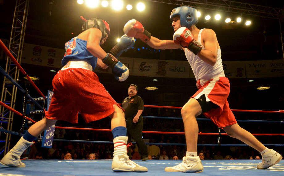 Joseph Rodriguez (right), shown during the 2012 San Antonio Regional Golden Gloves tournament at Scottish Rite Cathedral, is scheduled to fight today. Photo: John Albright / For The Express-News