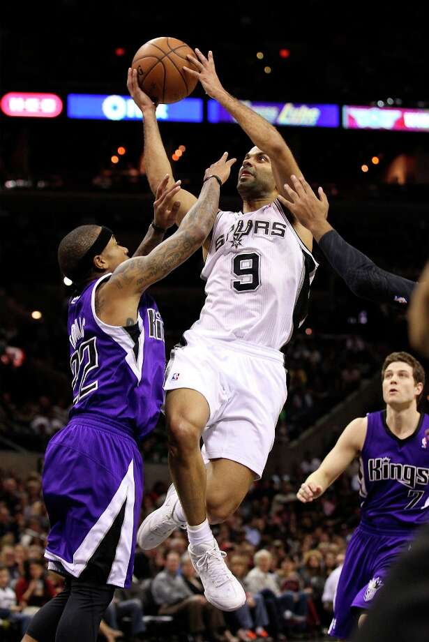 The Spurs' Tony Parker (9) goes for a shot in the paint against Sacramento Kings' Isaiah Thomas (22) late in the third quarter at the AT&T Center on Friday, Mar. 1, 2013. On this play, Parker sprained his left ankle and did not return for the rest of the game. Spurs defeated the Kings, 130-102. Photo: Kin Man Hui, San Antonio Express-News / © 2012 San Antonio Express-News